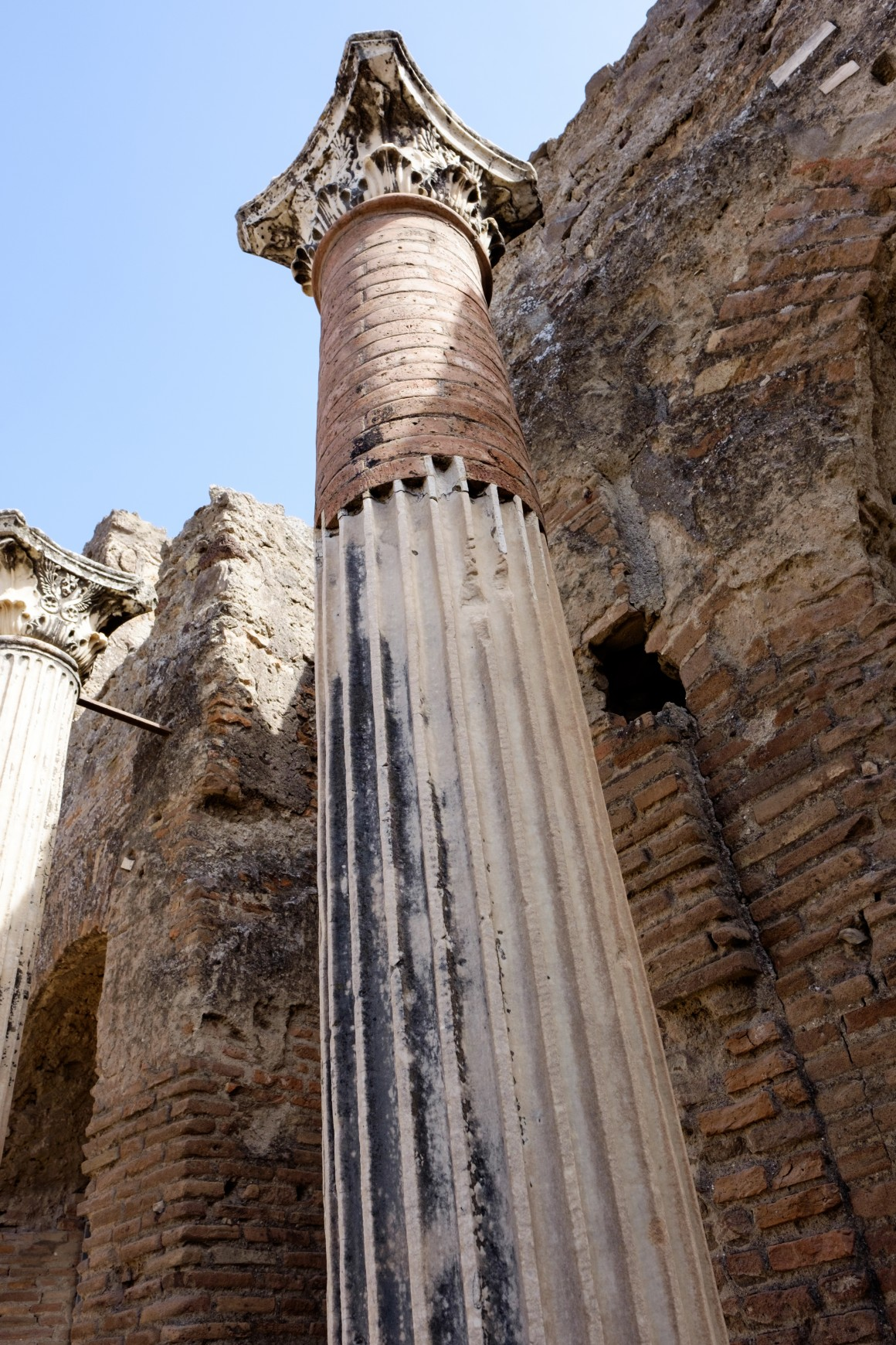 A column that was damaged in the earthquake 17 years before the erruption had been repaired.
