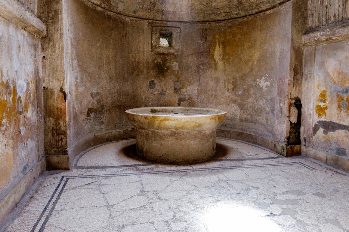 A carved fountain inside the baths.